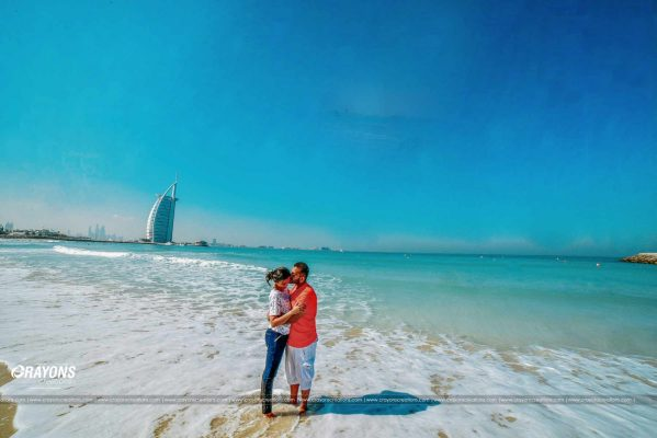 Crayons creations Couple in the dubai beach kissing post marriage wedding photography company Kochi Kannur Kerala