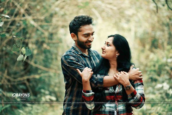 Crayons creations bride and groom posing inside forest photography company Kochi Kannur Kerala