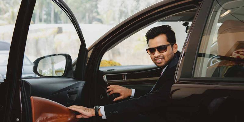 groom coming out of car photography company Kochi Kannur Kerala